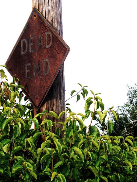 damaged dead end road sign
