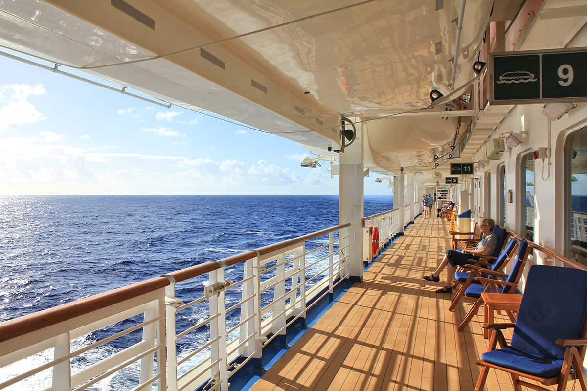 Cruise ship passenger in deck chair watching ocean
