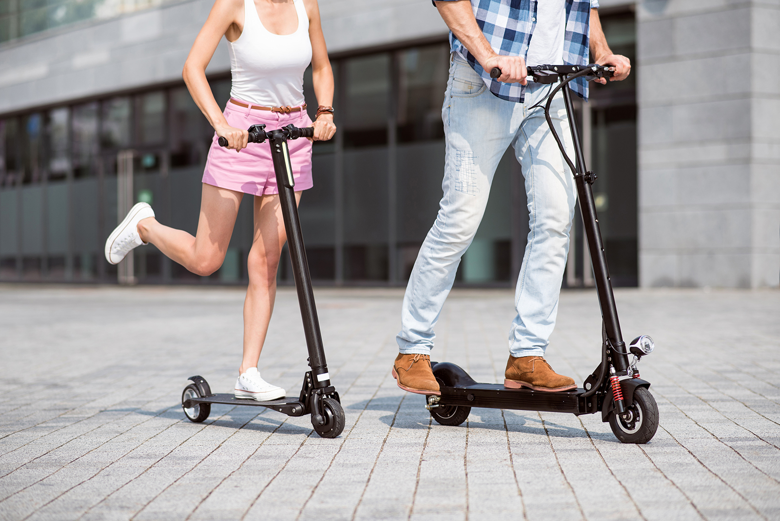 couple riding electric scooters