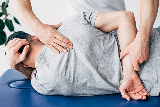 Back view of chiropractor back manipulation