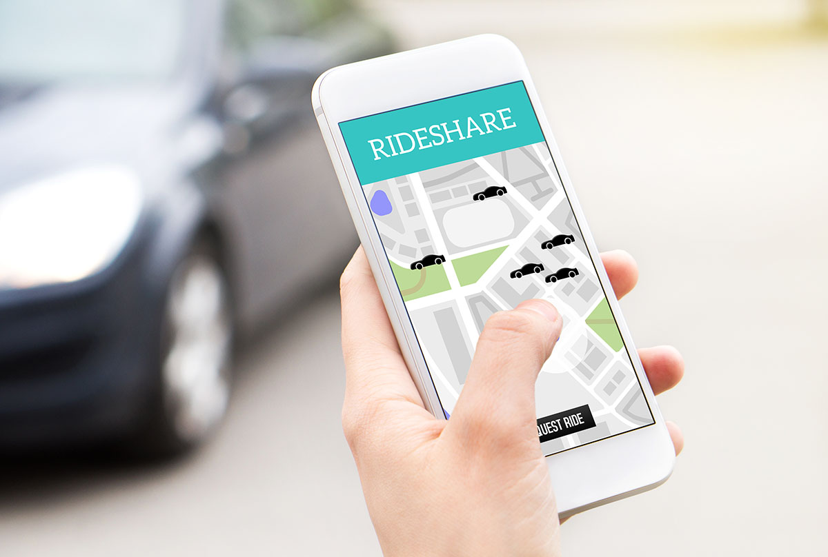 Ride share taxi service app on cell phone