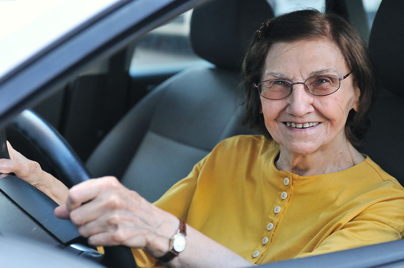 senior woman driving a car photo