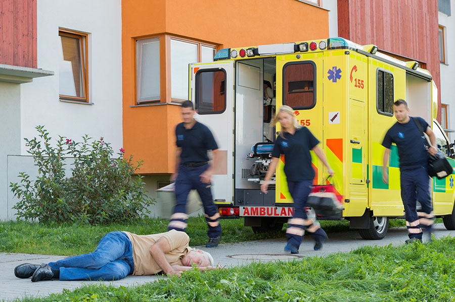 slip and fall accident photo paramedicts and fallen senior citizen
