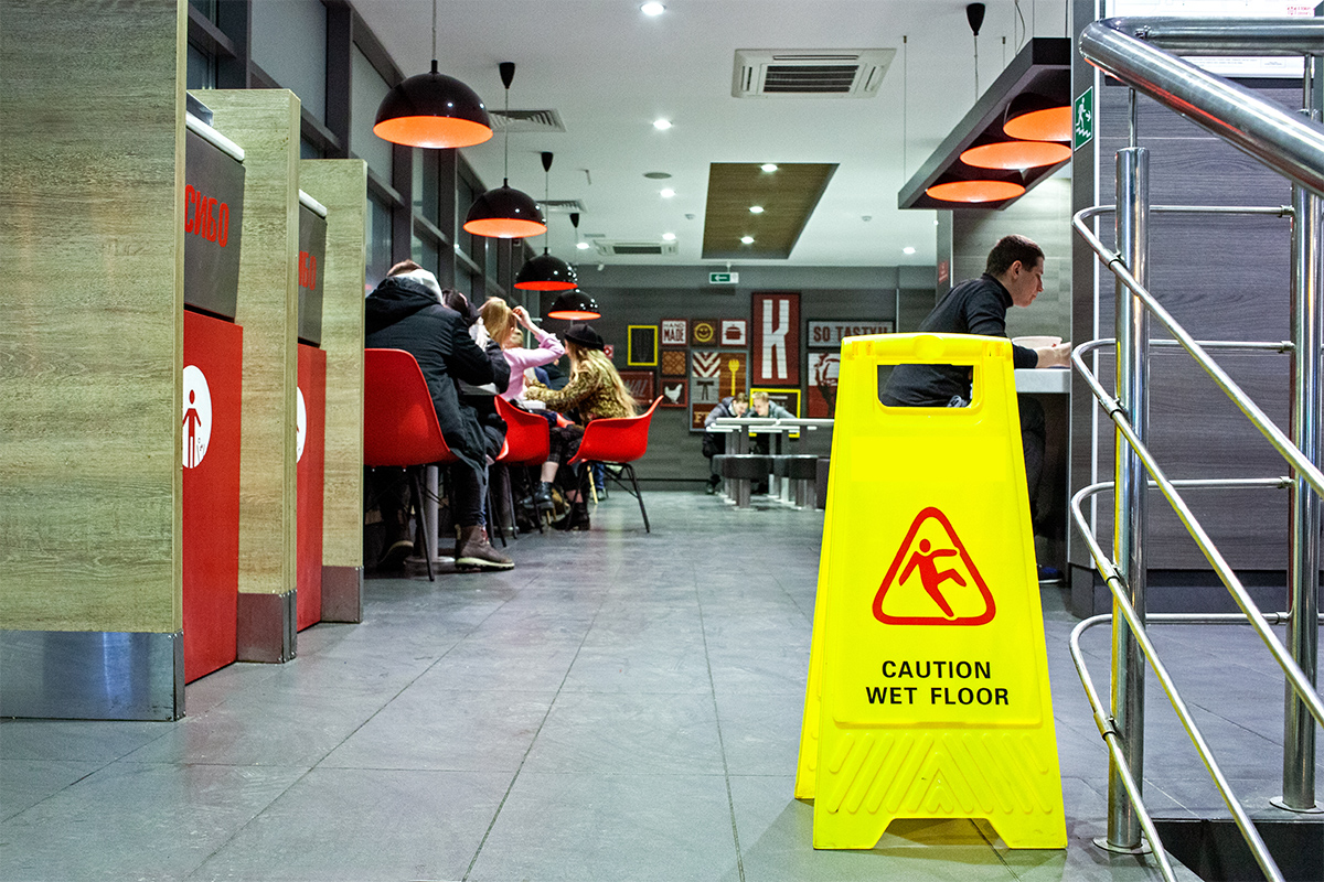 Sign showing warning of caution wet floor in a KFC restaurant