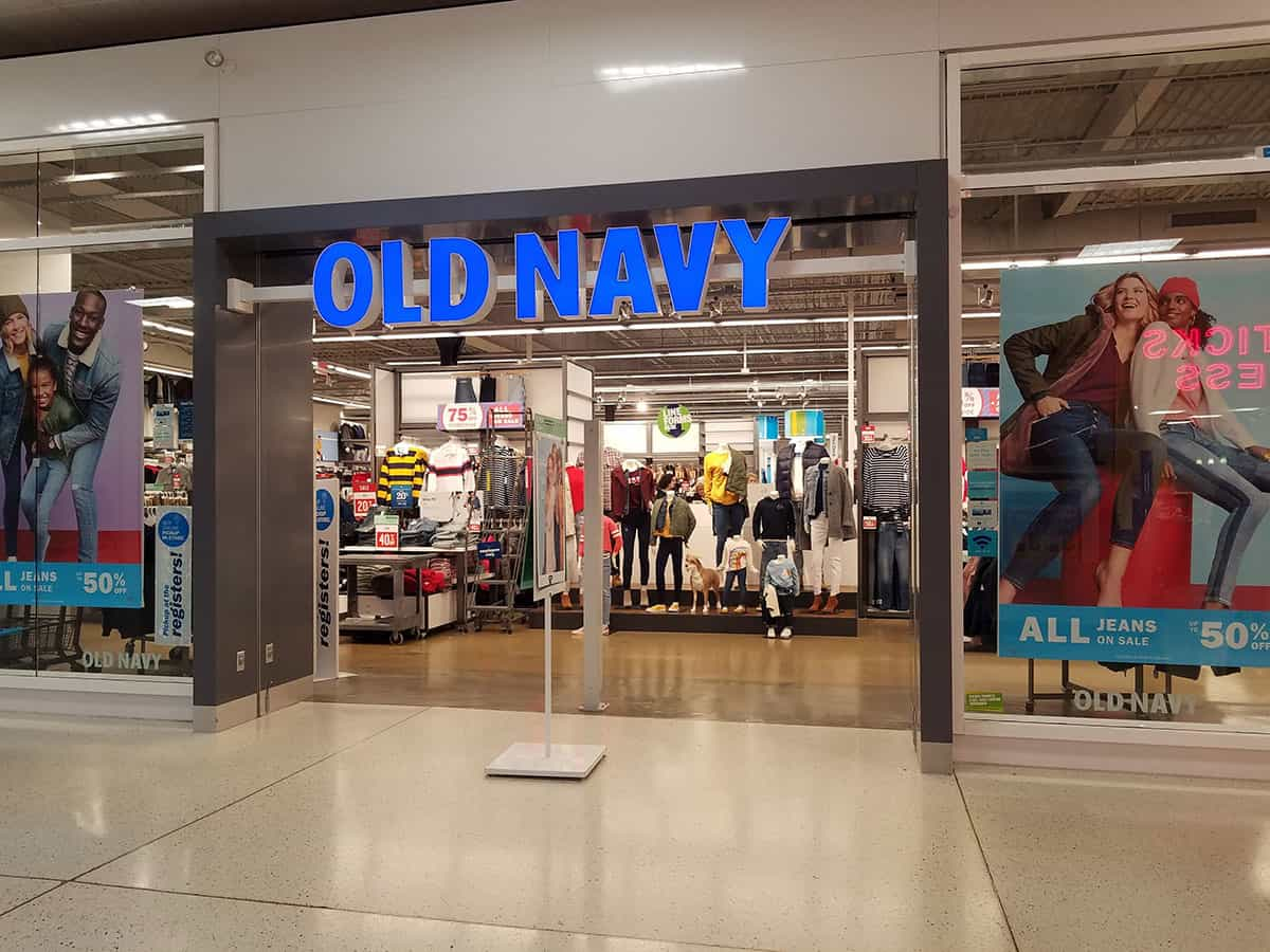Old navy sign above doorway to store in mall